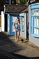 Albion Street blue door and windows and woman with Yorkshire Terrier at Broadstairs Kent England 2.jpg