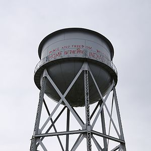 Alcatraz water tower - The restored tower in 2017. The red text is a recreation of writings created during the Occupation of Alcatraz.