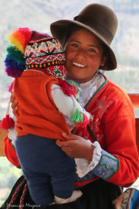 Amerindian girl holding her little brother.png