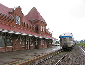 "Via Rail - The Ocean leaves the station at Amherst, Nova Scotia in July 2006 en route to Halifax. The image shows a vintage stainless steel ""Park"" observation car at the rear of the train. The other cars are newer Renaissance cars introduced by Via in 2003."