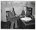 An unidentified man shakes hands with Mayor John F. Collins (13104666803).jpg