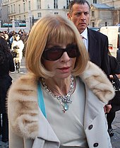 Anna Wintour wearing sunglasses as she walks along a street in Germany