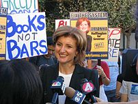 Arianna Huffington talks to the media during her short-lived attempt to become governor of California at UC Berkeley on September 11, 2003.