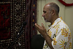 Atiq Azizi, a linguist with Regional Command (Southwest), recites a call to prayer during a friendship dinner at the Afghan Cultural Center at Camp Leatherneck in Helmand province, Afghanistan, July 25, 2013 130725-M-RF397-204.jpg