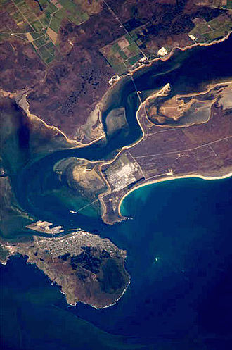 Bluff, New Zealand - Awarua Plain (top), Tiwai Point (centre) and Bluff (lower left) viewed from the International Space Station in 2008