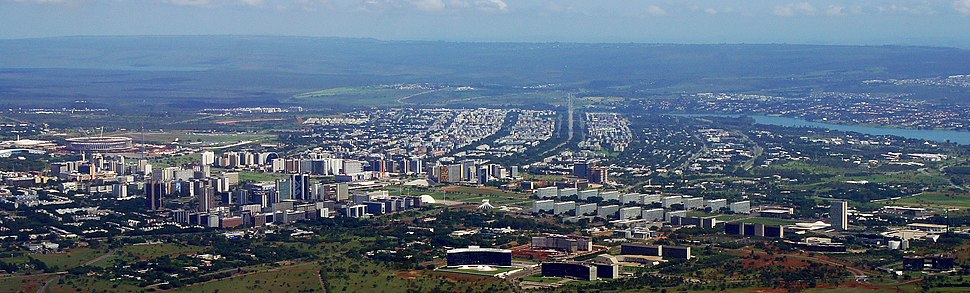 Aerial view of downtown Brasília (Pilot Plan) along the Monumental Axis, especially the new Mane Garrincha Stadium (left), the National Congress and the Three Powers Plaza (right). The entire residential area of North Wing (Asa Norte) is seen in the middle of the image.