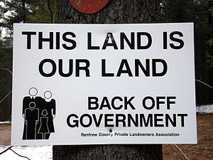 Sign with a libertarian political slogan in Re...