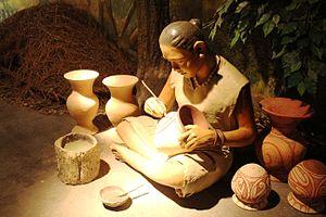 Ban Chiang - A diorama of an ancient Ban Chiang lady painting pots, Ban Chiang National Museum