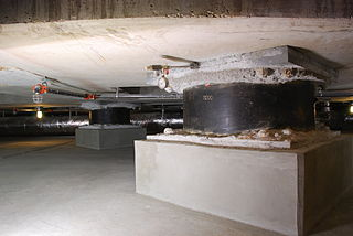 Seismic base isolation means of protecting a structure against earthquake