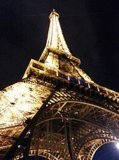https://upload.wikimedia.org/wikipedia/commons/thumb/d/de/Base_of_Eiffel_Tower_at_Night.jpg/170px-Base_of_Eiffel_Tower_at_Night.jpg