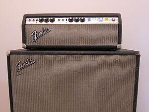 "Guitar amplifier - A Fender Bassman amp head with a 15"" speaker cabinet."