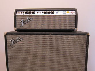 "Guitar amplifier - A Fender Bassman amp head with a 15"" speaker cabinet."