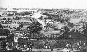 Small groups of armed men are dispersed throughout a rural area; in the foreground, officers on horseback confer. In the middle and background, large groups of mounted men charge a line of foot soldiers. Clouds of dark smoke, possibly gunpowder from the many cannons, hang over the field.
