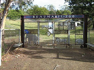 Hobart Zoo - The gates to the old Beaumaris Zoo site. Some of the remains of the original zoo can be seen in the background on the right.