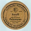 Beer mat of the German fur trader Curt Fuchs in Leipzig.jpg