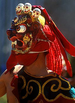 Chaam, sacred masked dances, are annually performed during religious festivals. Bhutan-masked-dance.jpg