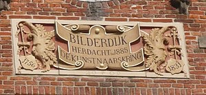 Willem Bilderdijk - Gable stone in top of facade to Grote Markt 11, the house Bilderdijk lived in when he died on the Grote Markt, Haarlem
