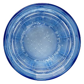 Blue glass with carbonated water.jpg