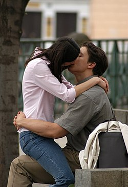 Boy Kissing His Girlfriend (8096546085).jpg