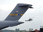 C-17 transport aircraft (tail) and Mi-24 helicopter.jpg