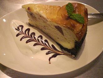 Dessert sauce - Cheesecake served with a cream and chocolate sauce dessert sauce