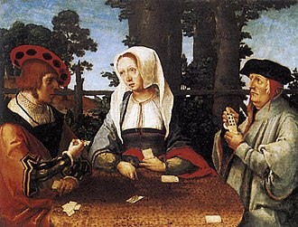 Primero - Card Players by Lucas van Leyden. It is assumed that the subject of this painting may not be the obvious three card players, but in fact it may refer to a secret political alliance between Spain and England against Francis I of France. The figure on the left would be Charles V and on the right Cardinal Wolsey, both entering into a secret agreement. The woman in the centre would be Margaret of Austria, sister of Charles V and regent of the Netherlands.