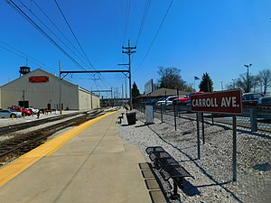 Carroll Avenue station - The Caroll Avenue station in April 2016. The freight house and yard are visible on the left side.