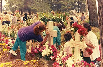 Day of the Dead - Families tidying and decorating graves at a cemetery in Almoloya del Río in the State of Mexico, 1995