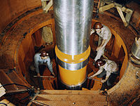 Checking the alignment of a turbine shaft at the top of the guide bearing in TVA's hydroelectric plant, Watts Bar Dam, Tenn.jpg