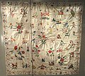 Child's coverlet, England, 1728, twill with linen warp and cotton weft, embroidered in wool - Patricia Harris Gallery of Textiles & Costume, Royal Ontario Museum - DSC09334.JPG