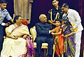 Children tying 'Rakhi' on the President, Shri Ram Nath Kovind's wrist, on the occasion of 'Raksha Bandhan', at Rashtrapati Bhavan, in New Delhi on August 07, 2017. Mrs. Savita Kovind, First Lady of India is also seen (1).jpg