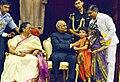 Children tying 'Rakhi' on the President, Shri Ram Nath Kovind's wrist, on the occasion of 'Raksha Bandhan', at Rashtrapati Bhavan, in New Delhi on August 07, 2017. Mrs. Savita Kovind, First Lady of India is also seen (1).jpg