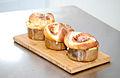 Cinnamon buns on cutting board (4669843711).jpg