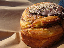 A cinnamon Danish with chocolate from a bakery in Denmark