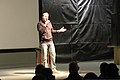 Comedian Rob Maher tells a joke during a comedy show for U.S. and coalition forces service members and civilians at Kandahar Airfield, Kandahar province, Afghanistan, Jan. 1, 2014 140101-Z-MH103-967.jpg