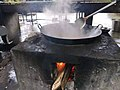 Cooking with a wok on an outdoor stove 4.jpg