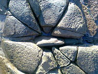 Cracks in rock resulting from stress.