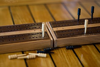 Cribbage - Traditional wooden board layout with wooden pegs