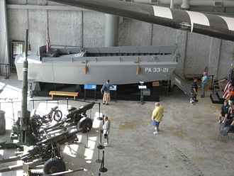 "The National WWII Museum - Artillery and a ""Higgins Boat"" on display in the museum lobby"