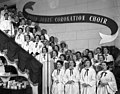 David Jones' Coronation Choir singing in the Elizabeth Street store, Sydney, June 1953 ? - photographer Australian Photographic Agency (7300142192).jpg