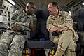 Defense.gov News Photo 110801-N-TT977-414 - Chairman of the Joint Chiefs of Staff Adm. Mike Mullen speaks with Commander of U.S. Forces-Iraq Gen. Lloyd Austin U.S. Army onboard a C-17.jpg