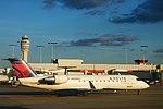 DeltaN848AS-CRJ200-TaxiBetweenGatesATL-Oct2015 (32751134706).jpg