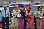 Deputy Director USAID Punjab Maggie Schoch presenting scholarship certificates to students under USAID's Merit and Needs Based Scholarship Program. (18058582923).jpg