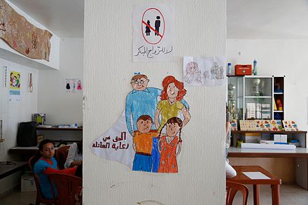 Drawings by young Syrian refugee girls in a community centre in southern Lebanon promote the prevention of child marriage. Drawings by young Syrian refugee girls in a community centre in southern Lebanon promote the prevention of child marriage. (14496389777).jpg
