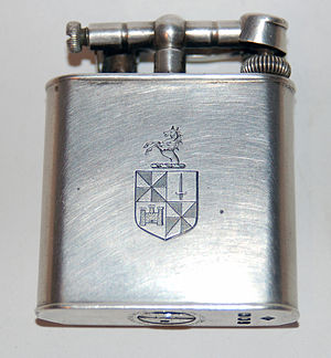 Alfred Dunhill Ltd. - A sterling silver Dunhill Unique lighter bearing a coat of arms