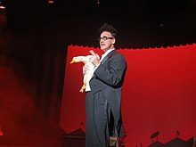 Ed Alonzo holding Bob the Duck while performing at Kings Island