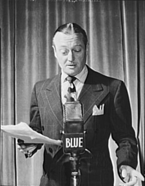 Edmund Lowe, American actor, standing at radio...
