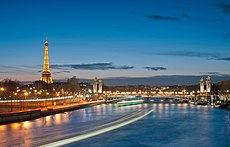 Eiffel Tower and Pont Alexandre III at night.jpg