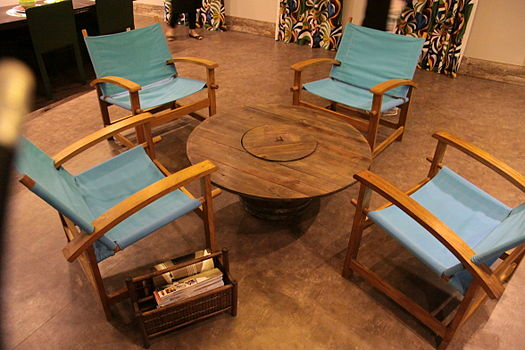 An electric wire reel reused as a center table in a Rio de Janeiro decoration fair. When consumers choose and reuse environmentally friendly material like this, they are practicing ethical consumerism. Electric wire reel reused in a furniture ecodesign.jpg