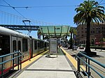 Embarcadero and Folsom station with train, July 2017.JPG